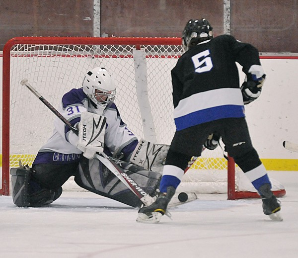 John Bapst goalie Carl Rydell (31) makes a stick save on a shot by Houlton Hodgdon player Brandon Ward (5) in the second period of their game at Sawyer Arena in Bangor on Wednesday, Dec 28, 2011.