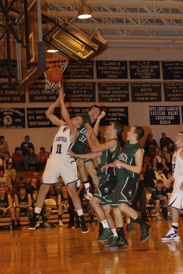 Leavitt's Jordan Hersom (32) goes up to defend against Hampden''s Dillon Corliss (11) during a Saturday, Nov. 26 exhibition game played at Hampden Academy.