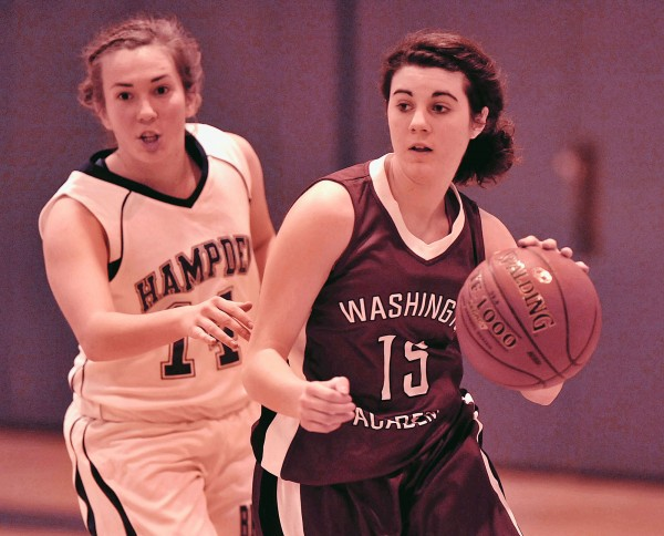Washington Academy girls team player Jessa Cushing (15) drives past Hampden Academy girls team player Alex Winchester (14) in their game  Saturday, Dec. 3, 2011.