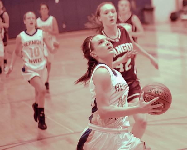 Hermon high school girl's player Raychel Alley (12) leads the pack to the basket just ahead of Mary Butler (42) in the first half of their game against the Bangor girl's team, Saturday Dec. 3, 2011.