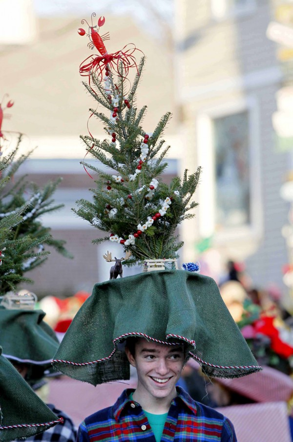 Jack Flynn wears a fresh-cut Christmas tree hat while marching in the Hat Parade on Saturday, Dec. 3 in Kennebunkport.