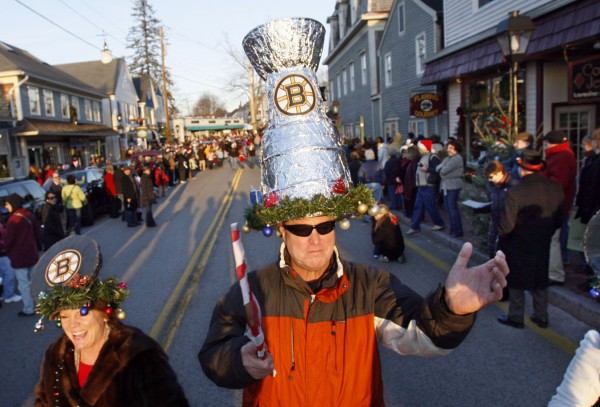 Mark Hannigan, of Milton, Mass., wears a Stanley Cup hat to commemorate the Bruins's championship season during the Hat Parade on Saturday, Dec. 3 in Kennebunkport.
