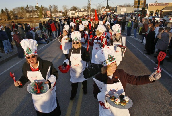 A group of friends from Massachusetts calling themselves the Lobster Chefs march in the Hat Parade. Their costumes included hats, aprons and even laminated menus.