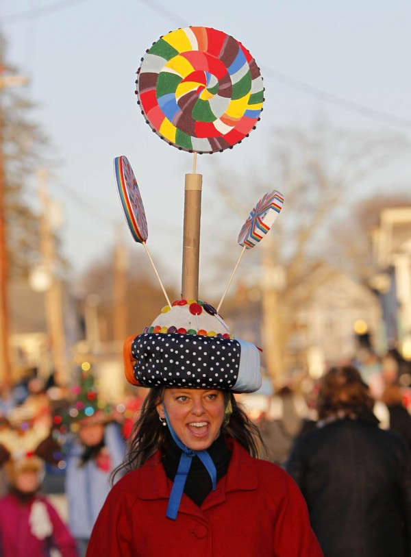 Danika Whitehouse of Kennebunk wears a lollipop hat while marching in the Hat Parade on Saturday, Dec. 3 in Kennebunkport. Whitehouse was part of a group calling themselves Ye Olde Candy Shoppe.