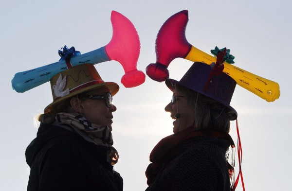 Helen Olson, of South San Francisco, Calif., (left) and Janet Theurer, of Cambridge, Mass., chat before the start of the Hat Parade on Saturday, Dec. 3 in Kennebunkport. &quotIts a joke in the family that the Theurers come out as babies as hammerheads. My brother has to wear extra, extra, extra large bike helmet and I can only wear men's hats — so that's the idea behind our hats,&quot explained Janet Theurer.