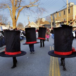 The Six Hats entertain the crowd in Dock Square on Saturday, Dec. 3 in Kennebunkport. The folks inside the hats won the grand prize for best costume in the sixth annual Hat Parade. The event was part of the Christmas Prelude, which continues this weekend in the Kennebunks.