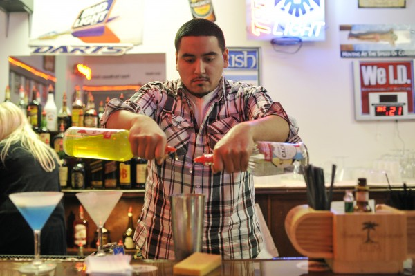 In this Wednesday, Dec. 21, 2011 photo, Yuma Amador practices mixing cocktails at the American Professional Bartender School in Villa Park, Ill.