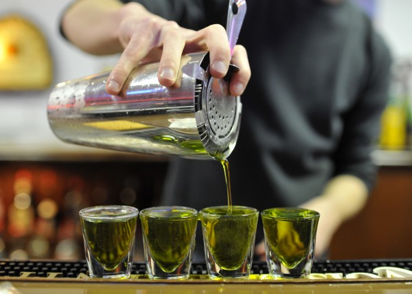 In this Wednesday, Dec. 21, 2011 photo, Jason Jarosz practices making specialty shots at the American Professional Bartender School in Villa Park, Ill.