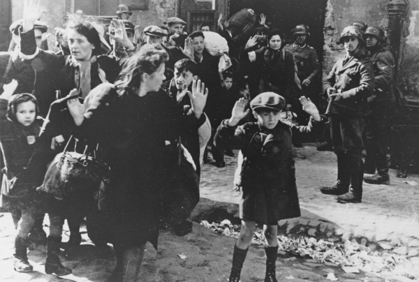 In this April 19, 1943 file photo, a group of Jews are escorted from the Warsaw Ghetto by German soldiers.
