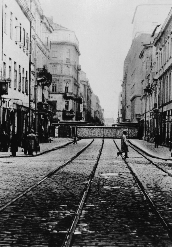 This Feb. 1, 1941 file photo shows one of the walls dividing Warsaw's Ghetto from the rest of the city, where 500,000 Jews lived. After a year of tough negotiations, Germany agreed Monday, Dec. 5, 2011, to pay pensions to about 16,000 Holocaust victims worldwide who survived wartime ghettos or were forced to hide from Nazi persecution.