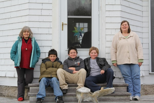 Teacher Paula Greatorex (from left), Andrew Barter, Michael Barter, Alex Tully and education technician Lisa Turner make up the entire population of Isle au Haut's one-room schoolhouse.