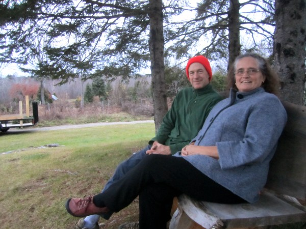 Nancy and Len Price, of Nutkin Knoll Farm, sit on a bench made by one of their friends who often pitches in at Nutkin Knoll Farm.
