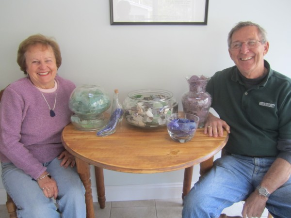 Helen and Bill Carney with a small sampling of their sea glass collection, which numbers more than 50,000 pieces.