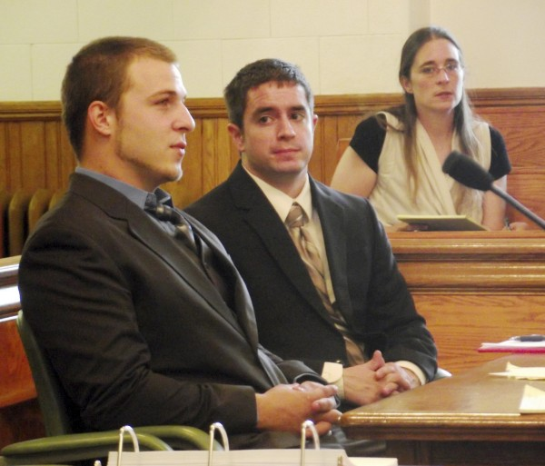 Nicklas Jones (left) listens to testimony in Aroostook County Superior Court in Caribou in August as his mother, Jerene Rosenbrook (background) looks on.