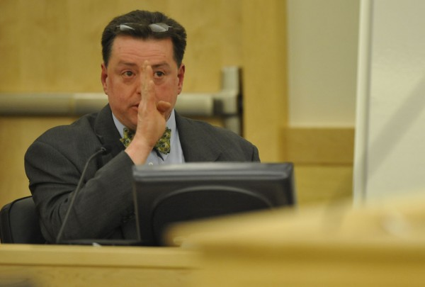 During Peter Robinson's bail hearing at Penobscot Judicial Center Friday, Dec. 2, 2011, deputy medical examiner Dr. Michael Ferenc gestures to describe some of the facial trauma suffered by Hudson contractor David P. Trask around the time of Trask's death on Nov. 12, 2011. The Penobscot County grand jury indicted Robinson on Wednesday, November 30, 2011 for the intentional or knowing murder and depraved indifference murder of Trask.