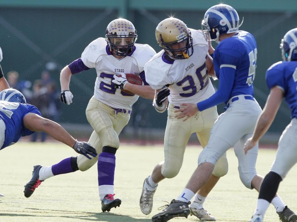 Spencer Cooke of Cheverus, a Fitzpatrick Trophy candidate, runs in the fourth quarter during the Class A state championship football game Saturday, Nov. 19, 2011, at Fitzpatrick Stadium in Portland.