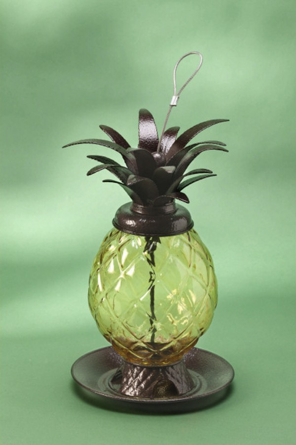 A pineapple birdfeeder welcomes songbirds to dine awhile.