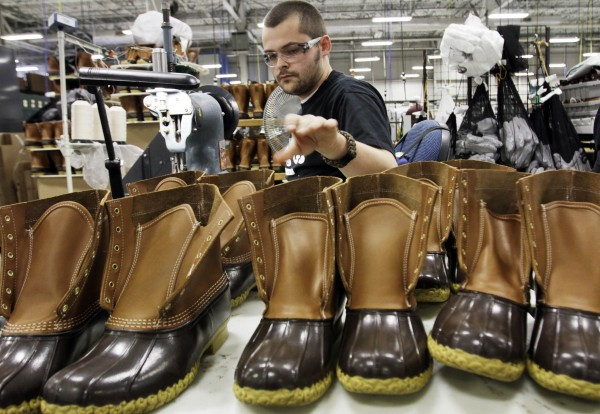 In this photo from Dec. 14, 2011, Eric Rego of East Boothbay stitches boots in the facility where L.L. Bean boots are assembled in Brunswick. L.L. Bean's famed hunting boots are seeing a surge in popularity, necessitating the hiring of more than 100 additional employees to make them.