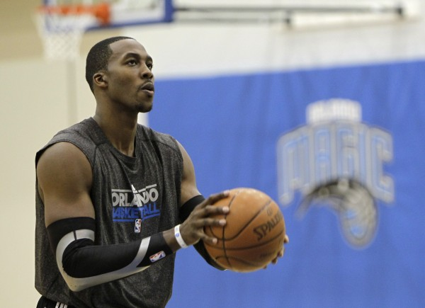 Orlando Magic center Dwight Howard shoots free throws after practice on the first day of NBA basketball training camp in Orlando, Fla., Friday, Dec. 9, 2011