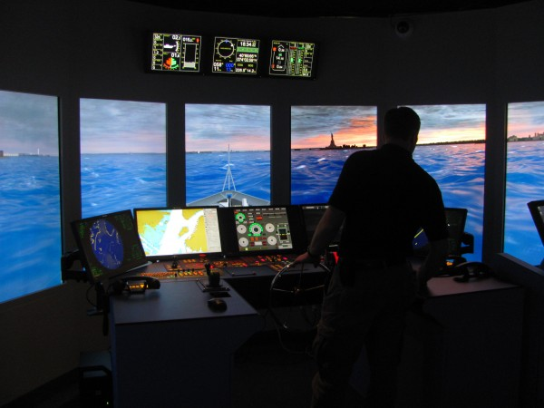 Bryan Hammond, a Maine Maritime Academy senior from Connecticut, mans the helm as the simulated ship he is driving steams toward the Statue of Liberty in New York Harbor during a recent demonstration.