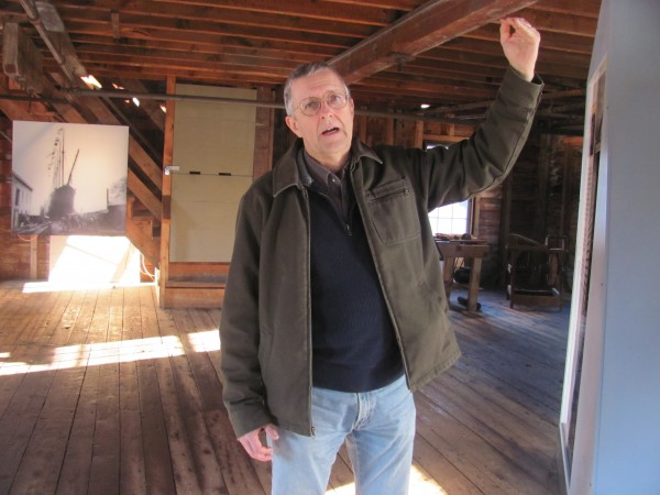 Nathan Lipfert, senior curator at Maine Maritime Museum in Bath, describes on Thursday, Dec. 22, 2011, some of the work that will be done over the winter to shore up the museum's 104-year-old Paint and Treenail Building, thanks in part to a $10,000 grant received recently.