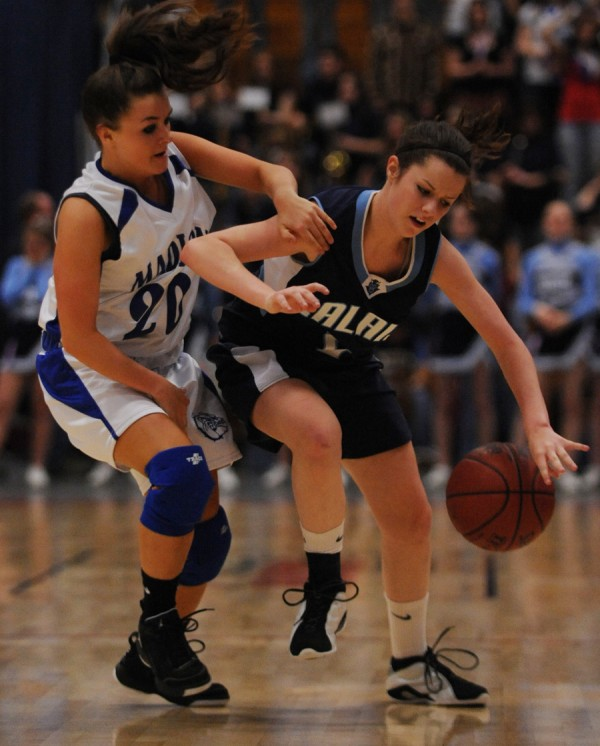 Calais' Allison Hill (right) is fouled by Madison's Kelley Costa during Calais' state-title win in 2010. Top-seeded Calais was knocked off in the quarterfinal round last season and is eager to begin its quest to return to the tourney.