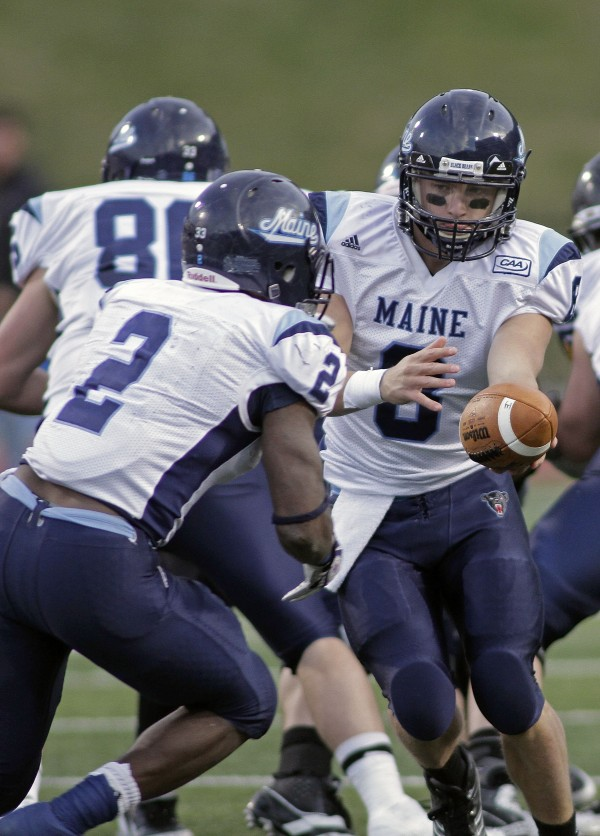 Maine's quarterback Warren Smith (8) hands off to Pushaun Brown (2) during the second half of an NCAA college football game against Appalachian State, Saturday, Dec. 3, 2011, in Boone, N.C. Maine defeated Appalachian State 34-12.
