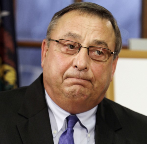 Gov. Paul LePage pauses as he answers questions at a news conference at the State House in Augusta on Tuesday, Dec. 6, 2011.