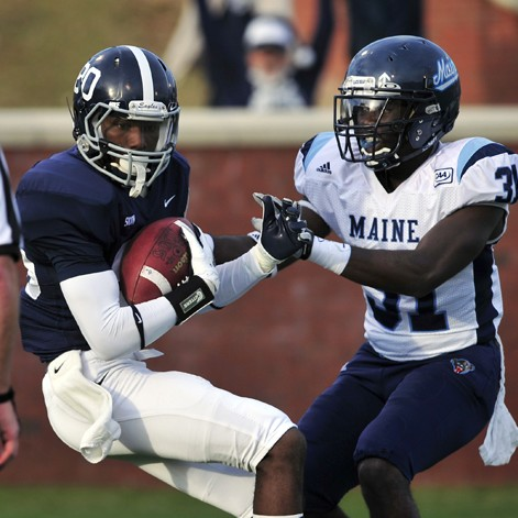 Georgia Southern wide receiver Kentrellis Showers (80) catches a touchdown pass in front of Maine corner back Axel Ofori (31) during the second half of an NCAA college football game, Saturday, Dec. 10, 2011 in Statesboro, Ga. Georgia Southern defeated Maine 35-23 to advance to the semifinals.