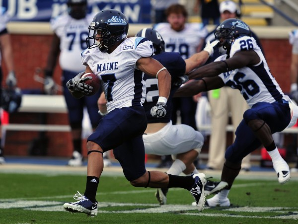 Maine running back Roosevelt Boone (7) returns a kick off for a touchdown during the first half of an NCAA college football game against Georgia Southern on Saturday, Dec. 10, 2011 in Statesboro, Ga.