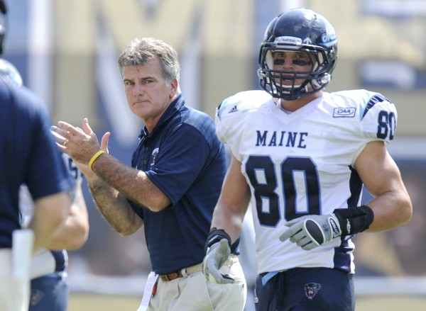 Maine head coach Jack Cosgrove (left) celebrates after Derek Buttles (80) scored a touchdown against Pittsburgh in September 2011.