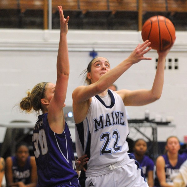 The University of Maine's Samantha Wheeler (right) goes up for a shot over James Madison University's Nikki Newman during the first half of the game in Orono on Thursday evening.