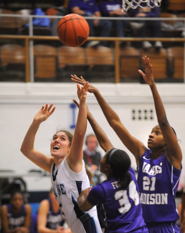James Madison University's Kiara Francisco (center) and Crystal Ross block a shot by the University of Maine's Brittany Williams during the first half of the game in Orono on Thursday evening.