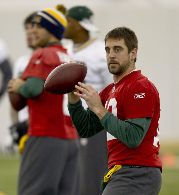 Green Bay Packers quarterback Aaron Rodgers throws a pass during an NFL football practice, Wednesday, Dec. 21, 2011, in Green Bay, Wis. Rodgers was selected as the 2011 Male Athlete of the Year chosen by members of The Associated Press after his MVP performance in the Packers' Super Bowl victory in February and his stellar play during the team's long unbeaten run this season.