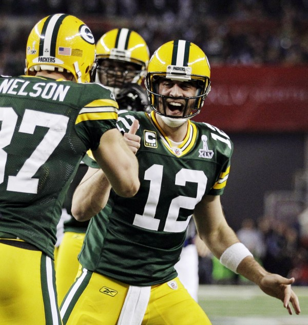 Green Bay Packers quarterback Aaron Rodgers (12) celebrates with Jordy Nelson (left) after Nelson scored a touchdown during the first half of the NFL Super Bowl XLV football game against the Pittsburgh Steelers in Arlington, Texas, in February 2011.