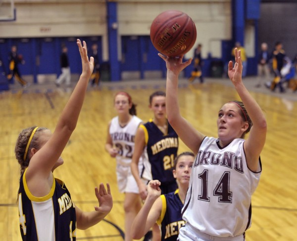 Orono's Leya Bryant (14) goes to the hoop past Medomak Valley's Missy Philbrook (44) in the second half of their pre-season game at the Bangor Auditorium Saturday, Nov. 26, 2011.
