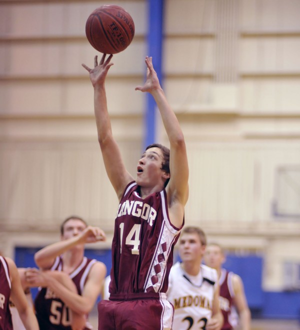 Bangor's Colin Kimsey (14) puts up a shot in the first half of their game against the Medomak Valley boy's team in preseason action at the Bangor Auditorium Saturday, Nov. 26, 2011.