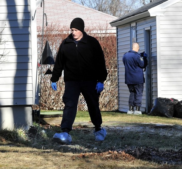 Maine State Police investigators work with protective clothing while gathering evidence and clues Tuesday, Dec. 20, 2011, at the home in Waterville, Maine, where 20-month-old Ayla Reynolds lived and disappeared last Friday.