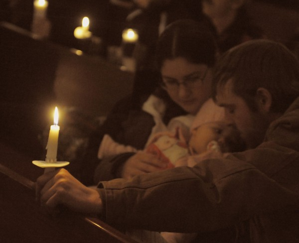 Ken Brown, Hannah Letourneau and their daughter Mackenzie Brown listen as prayers are offered at the First Congregational Church, for 20-month-girl, Ayla Reynolds on Wednesday, Dec. 21, 2011 in Waterville.