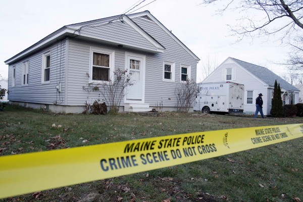 A state trooper walks outside the home of missing 20-month-old Ayla Reynolds, Thursday, Dec. 22, 2011, in Waterville, Maine.