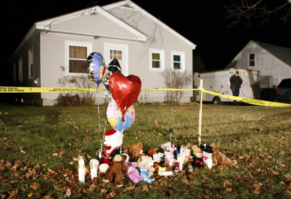 A memorial grows outside the home of missing 20-month-old Ayla Reynolds, Thursday, Dec. 22, 2011, in Waterville. Investigators put up crime scene tape around the house on Thursday.