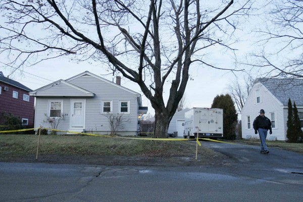 A state trooper walks outside the home of missing 20-month-old Ayla Reynolds, Thursday, Dec. 22, 2011, in Waterville, Maine. Investigators put up crime scene tape around the house on Thursday.