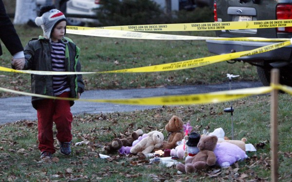 Isaiah Vear, 5, of Waterville, Maine, leaves a memorial after placing a toy for missing 20-month-old Ayla Reynolds outside the toddler's home, Thursday, Dec. 22, 2011, in Waterville. investigators  put up crime scene tape around the house on Thursday.