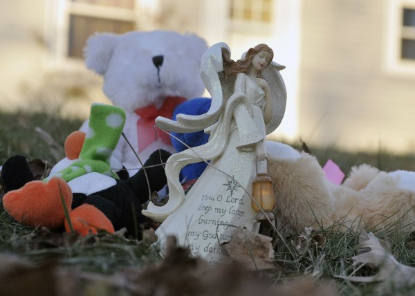 A collection of toys and mementos are placed on the lawn in front of the Violette Avenue home in Watervile, Maine, where police and the FBI are investigating  the disappearance of 20 month-old Ayla Reynolds, Tuesday, Dec. 21, 2011.