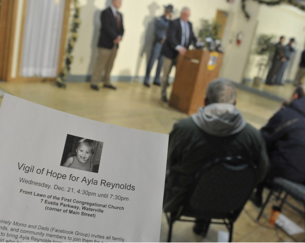 Waterville police were handing out flyers as chief of police Joseph Massey, at podium, speaks to members of the media regarding the investigation into the disappearance of 20 month-old Ayla Reynolds at a conference at city hall  in Waterville, Maine, Tuesday, Dec. 21, 2011.