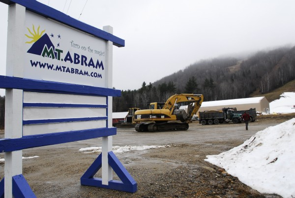 Workers prepare the new parking lot and approach to the new lodge at Mt. Abram ski hill in Greenwood. The new lodge is visible in the background on Nov. 29, 2011.