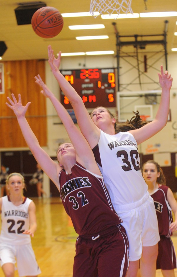 Nokomis Regional High School's Anna Mackenzie (right) makes a shot over Maine Central Institute's Kylee Alton during the first half of the game in Newport on Friday evening.