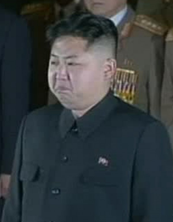 In this image made from KRT television, Kim Jong Un grimaces in front of the body of his father and North Korean leader Kim Jong Il at the Kumsusan Memorial Palace in Pyongyang, North Korea, Tuesday, Dec. 20, 2011.