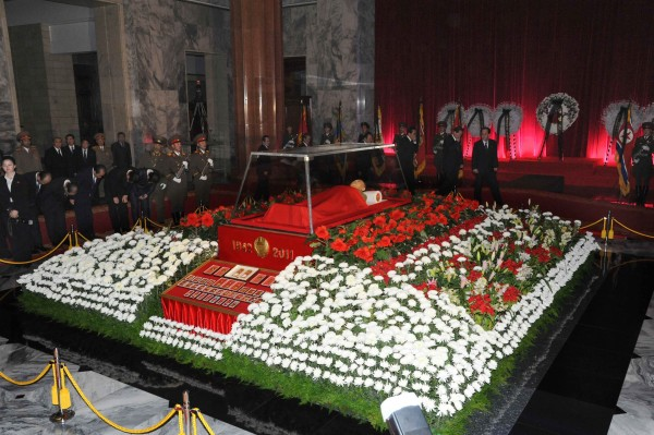 Mourners pay respects as they view the body of North Korean leader Kim Jong Il at the Kumsusan Memorial Palace in Pyongyang, North Korea, Tuesday Dec. 20, 2011.