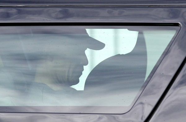President Barack Obama is seen through a vehicle window as his motorcade returns to his holiday vacation rental home in Kailua, Hawaii, Tuesday, Dec. 27, 2011.